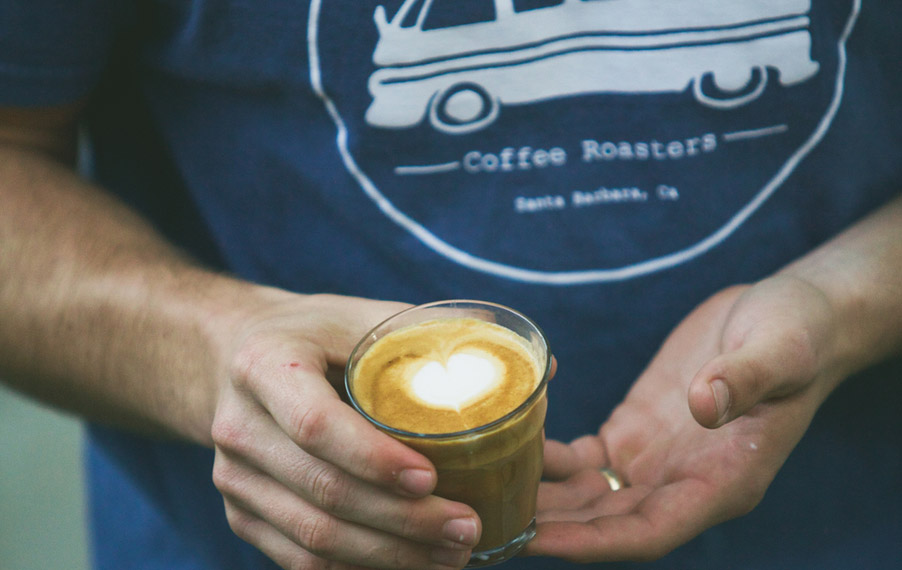 Close up of a man holding a cup of coffee