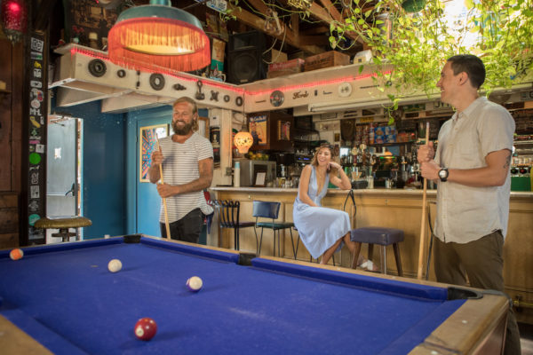 Photo of people playing Pool at a bar
